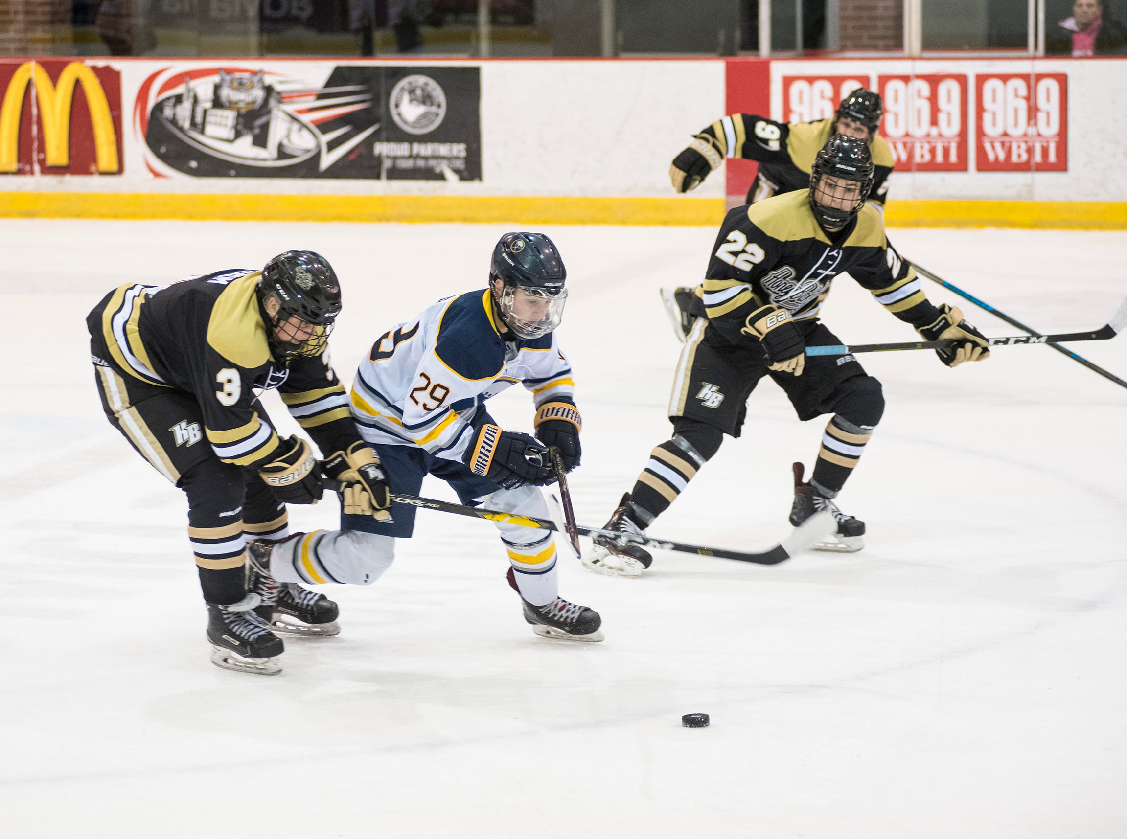 Detroit Honeybaked forward Emmett Pegrum (3) goes to steal the puck from Buffalo Jr. Sabres forward Nicholas Peluso during the Silver Stick Finals BAAA Championship match Sunday, Jan. 6, 2019 at McMorran Arena.