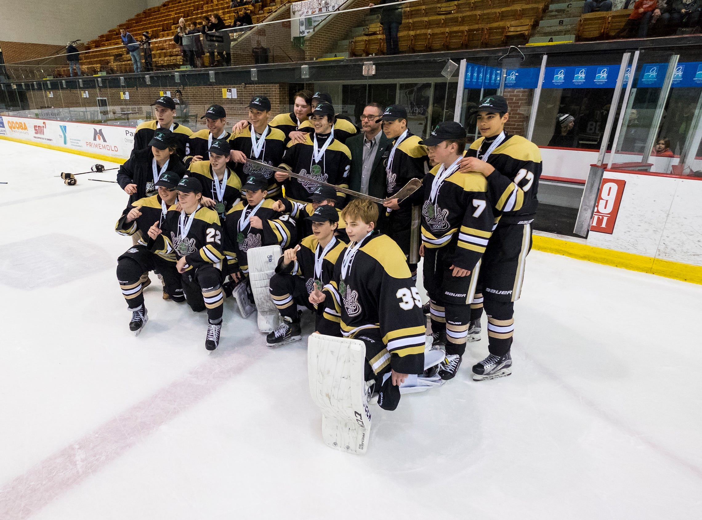 The Detroit Honeybaked celebrate their 8-2 victory over Buffalo Jr. Sabres after the Silver Stick Finals BAAA Championship match Sunday, Jan. 6, 2019 at McMorran Arena.