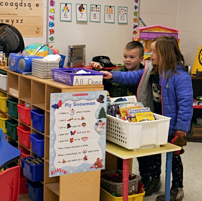Millbrook student Carly McKee, 7, and her brother, 5-year-old Johnny, at the Elm Drive Elementary School open house on Jan. 3, 2019. The school re-opened the previous day after being closed for months for mold remediation and renovations.