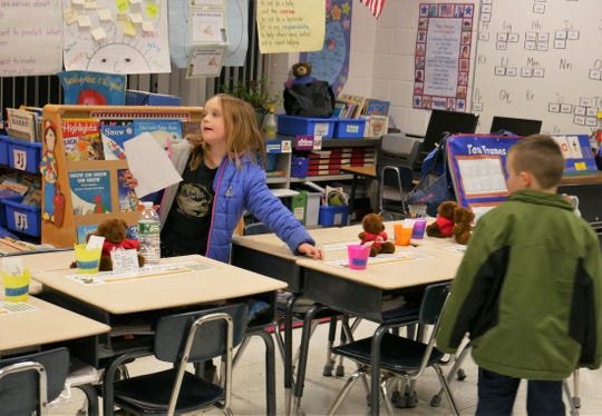 Millbrook student Carly McKee, 7, shows off her classroom to her mother, Angela, at the Elm Drive Elementary School open house on Jan. 3, 2019. The school re-opened the previous day after being closed for months for mold remediation and renovations.