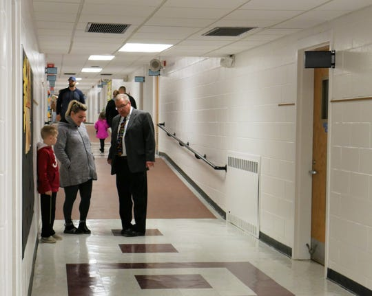 Millbrook Superintendent Philip D'Angelo (right) talks to a parent at the Elm Drive Elementary School open house on Jan. 3, 2019. The school re-opened on Jan. 2, 2019, after being closed for months for mold remediation and renovations.