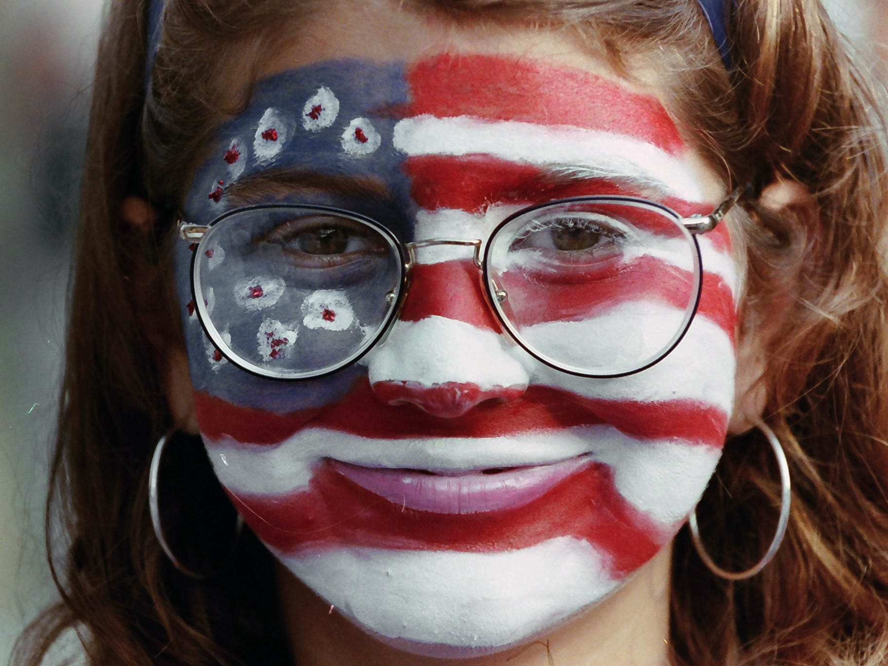 A  Clinton supporter with an American flag painted on her face during a visit to York July 18, 1992. Hillary Clinton and Tipper Gore accompanied their husbands, Dem nominees Bill Clinton and Al Gore, on a 1,000-mile bus trip after winning their party's nod in July 1992.