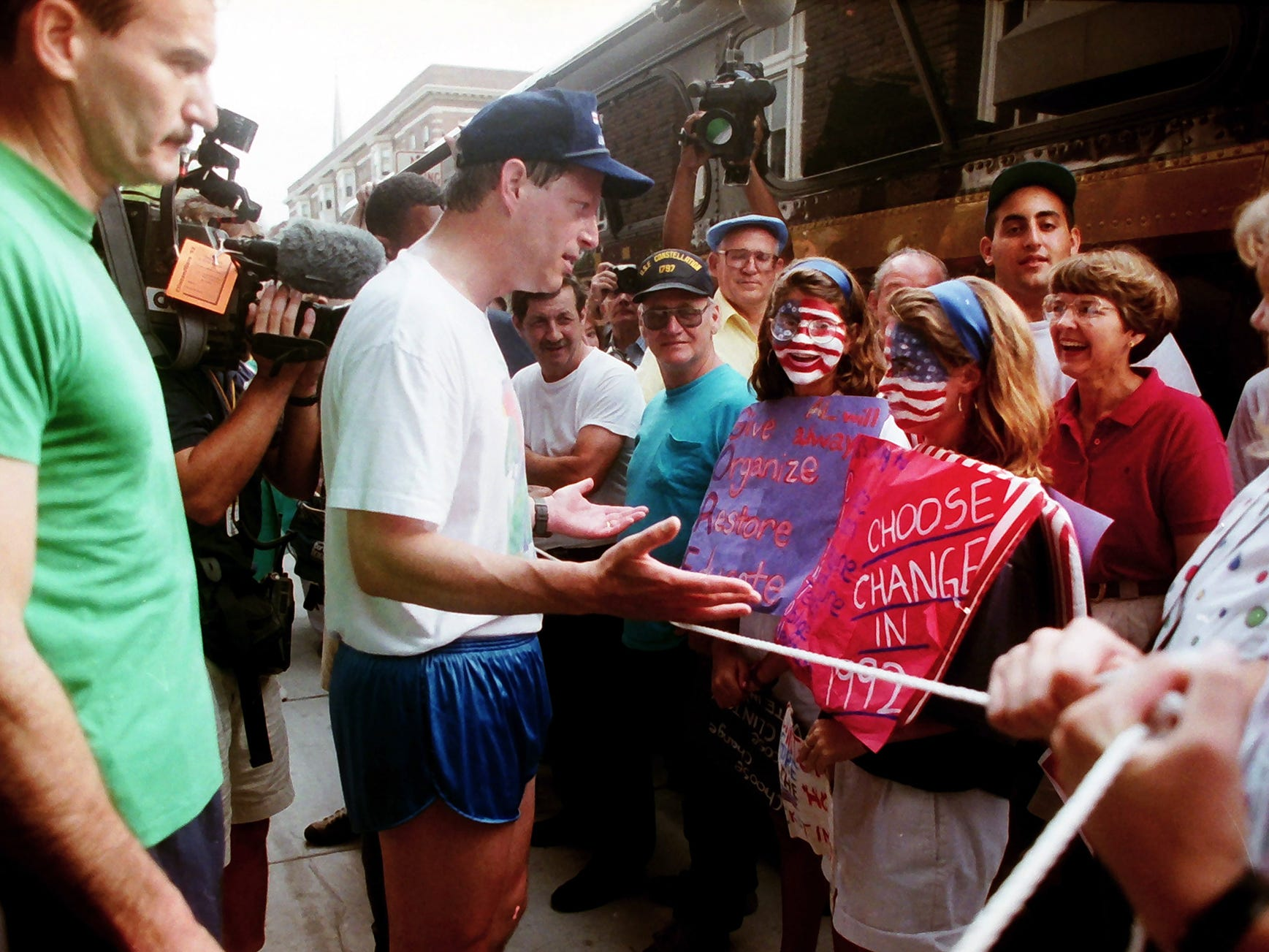 Al Gore, wearing shorts, talks to supporters outside the Yorktowne Hotel during a visit to York on July 18, 1992 after a run through York with Bill Clinton. Hillary Clinton and Tipper Gore accompanied their husbands, Dem nominees Bill Clinton and Al Gore, on a 1,000-mile bus trip after winning their party's nod in July 1992.