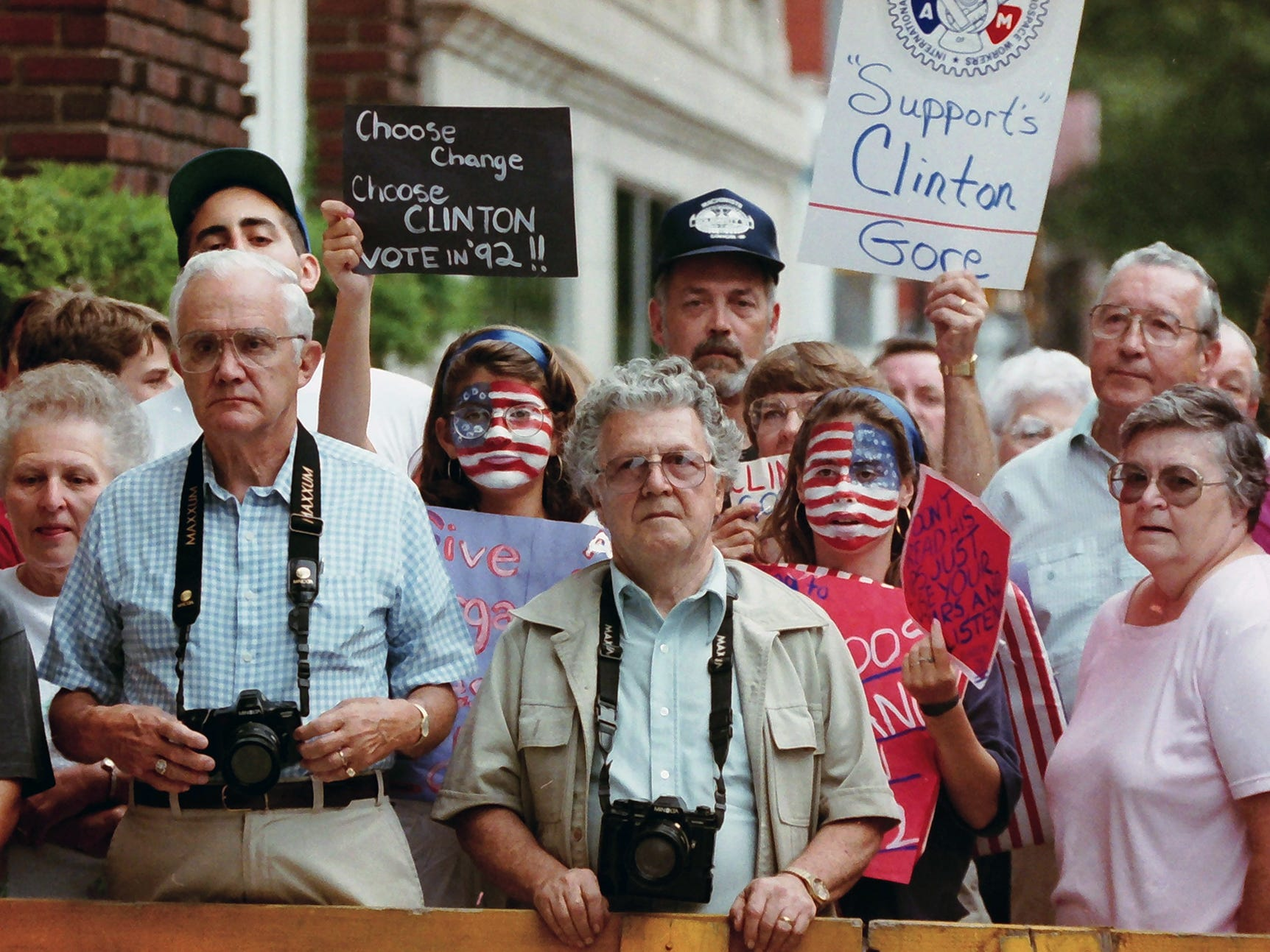 Clinton supporters wait for a glimpse of the visitors during a visit to York July 18, 1992. Hillary Clinton and Tipper Gore accompanied their husbands, Dem nominees Bill Clinton and Al Gore, on a 1,000-mile bus trip after winning their party's nod in July 1992.