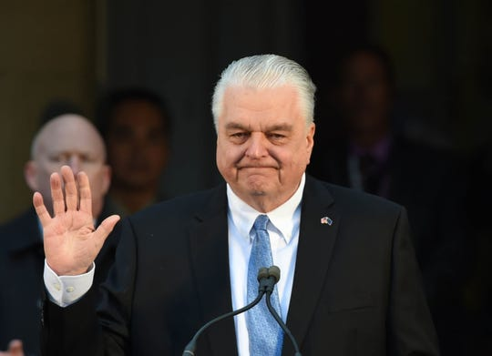 Steve Sisolak concludes his speech after being sworn in as governor of Nevada on the step of the Capitol in Carson City on Monday Jan 7, 2019.