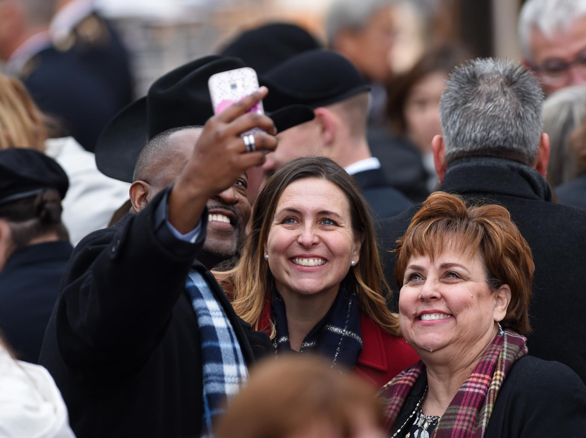 Images of faces at Steve Sisolak's inauguration at the Nevada State Capitol in Carson City, Nevada on Monday Jan. 7, 2018.