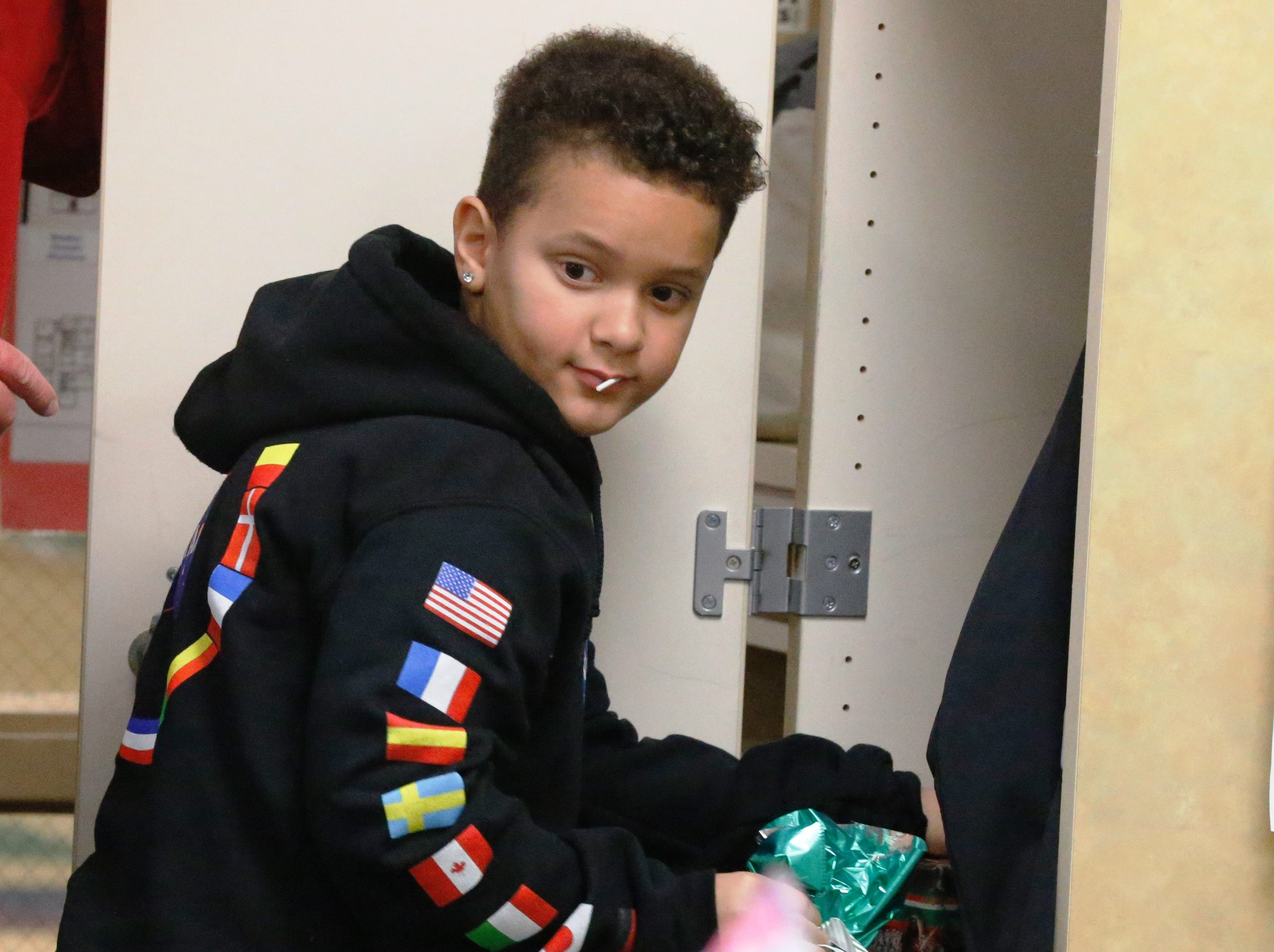 Javeonte Johnson, a fourth-grader at Fairview Elementary School gets a gift out of his locker as he and classmate D. J. Allen surprised classmate Joshua idle and his younger brother, Ryan, with an Xbox One S. Allen and Johnson founded the 'Josh Squad,' a store that sold pictures to raise money for Idle. Idle was involved in an accident and lost his mom in Dec. 2018.