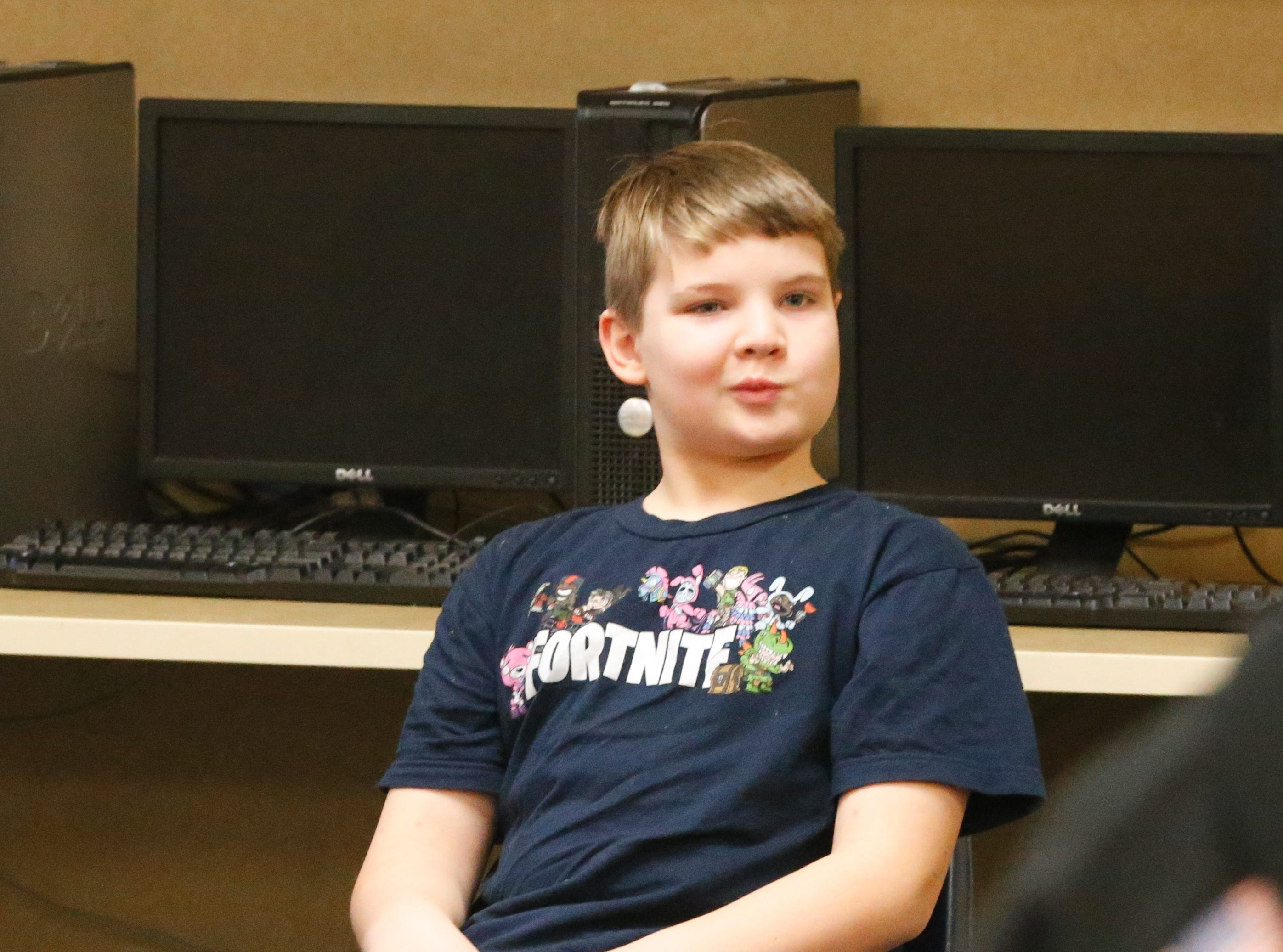 Joshua Idle, a fourth-grader at Fairview Elementary School in Richmond, listens as his teacher, Jim Jeffries makes an announcement. Idle and his younger brother, Ryan, were surprised with an Xbox One S by classmates Javeonte Johnson and D. J. Allen, who founded the 'Josh Squad,' a store that sold pictures to raise money for Idle. Idle was involved in an accident and lost his mom in Dec. 2018.
