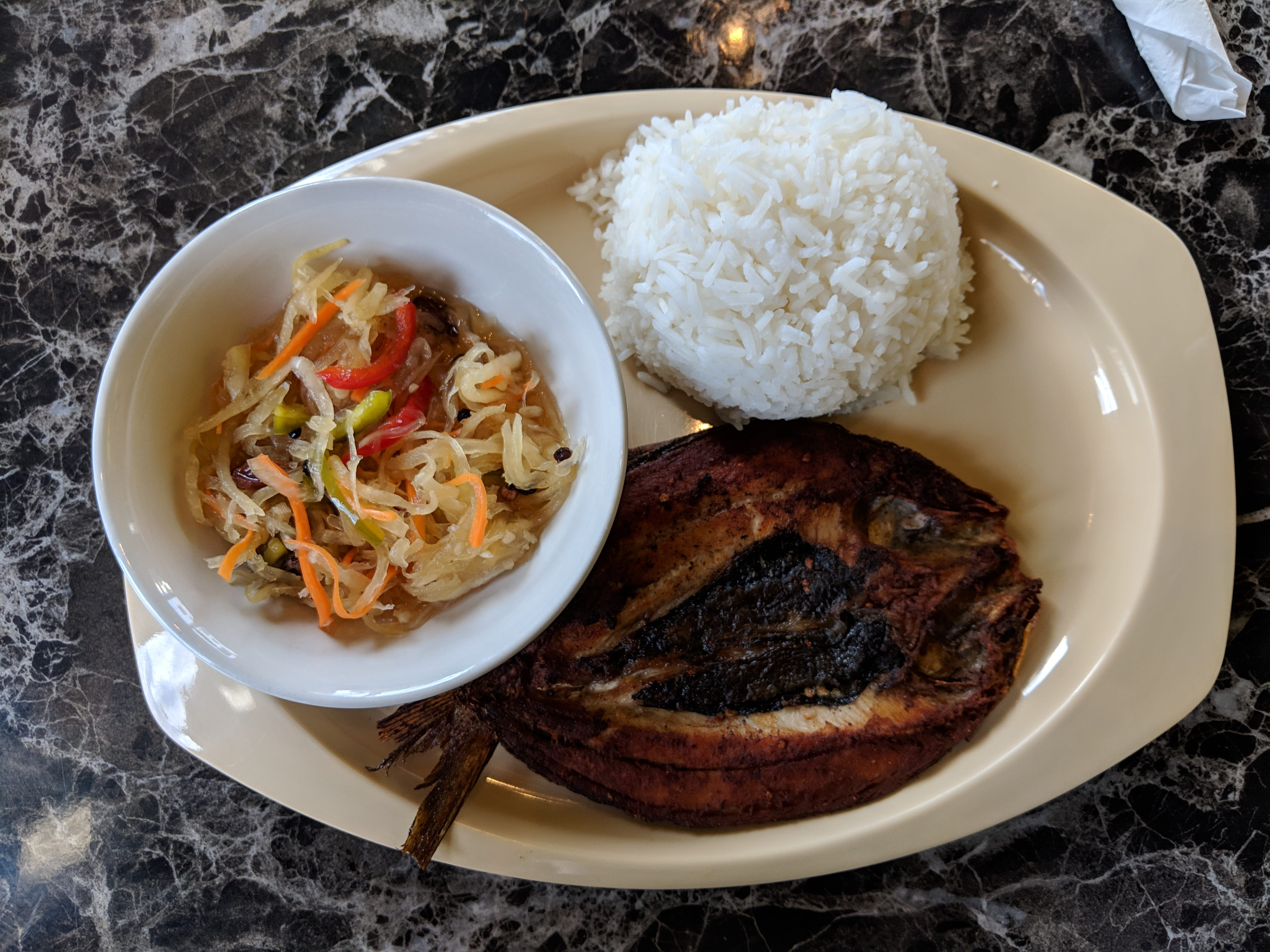 Casa Merlita's signature dish, fried milkfish with pickled papaya salad.