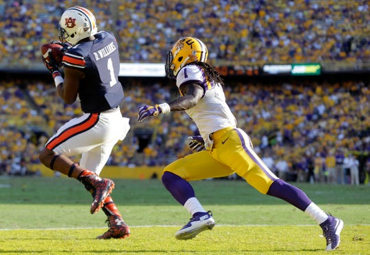 Auburn wide receiver D'haquille Williams (1) pulls in a touchdown reception in front of LSU defensive back Donte Jackson (1) in 2015.
