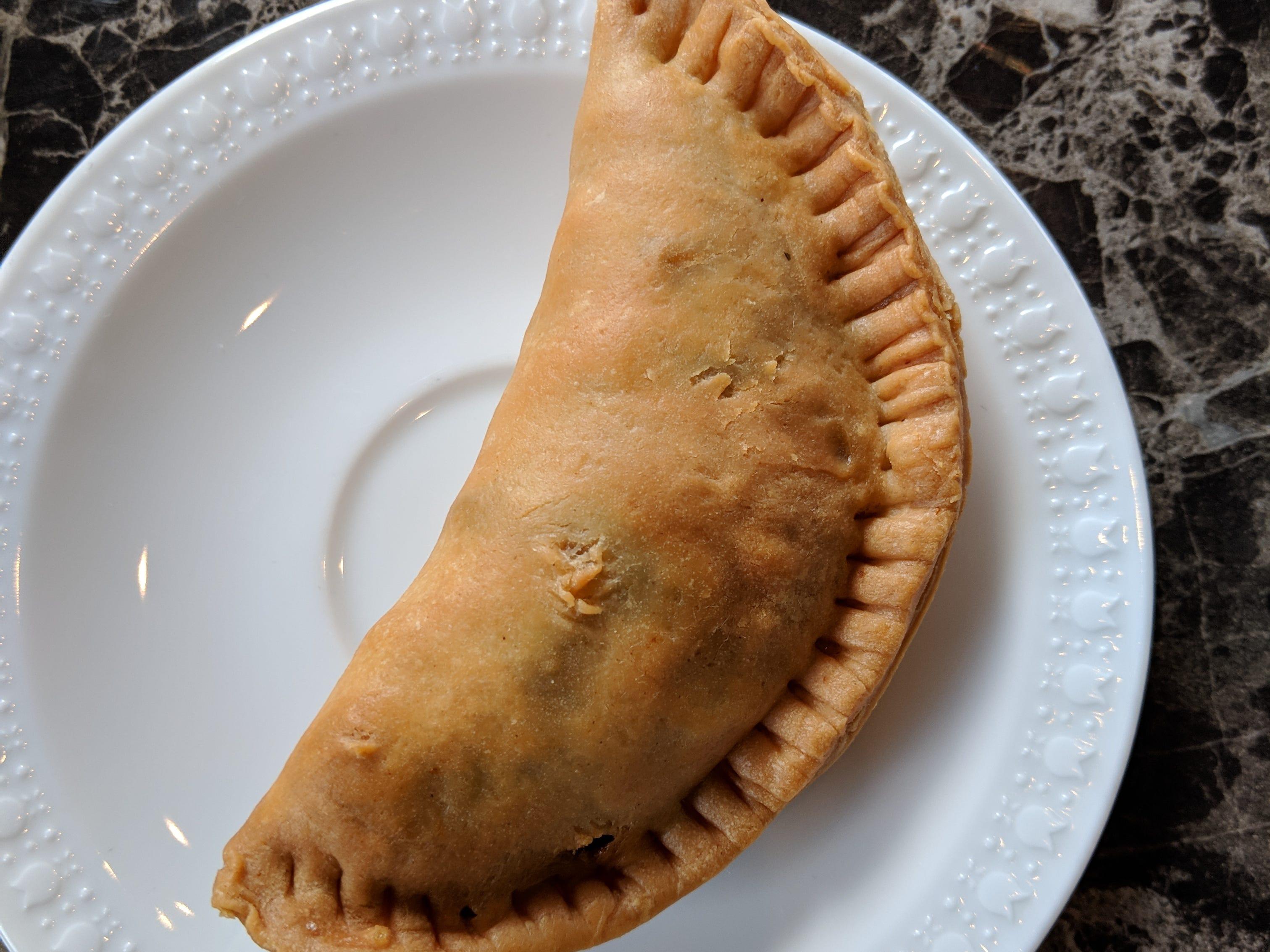 A chicken empanada.