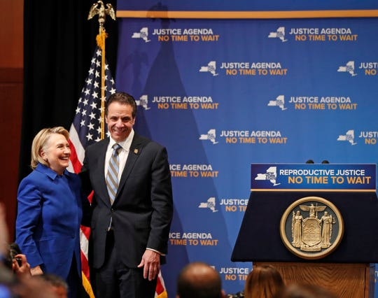 Former Secretary of State Hillary Clinton, left, and New York Governor Andrew Cuomo appear on stage together, Monday, Jan. 7, 2019.