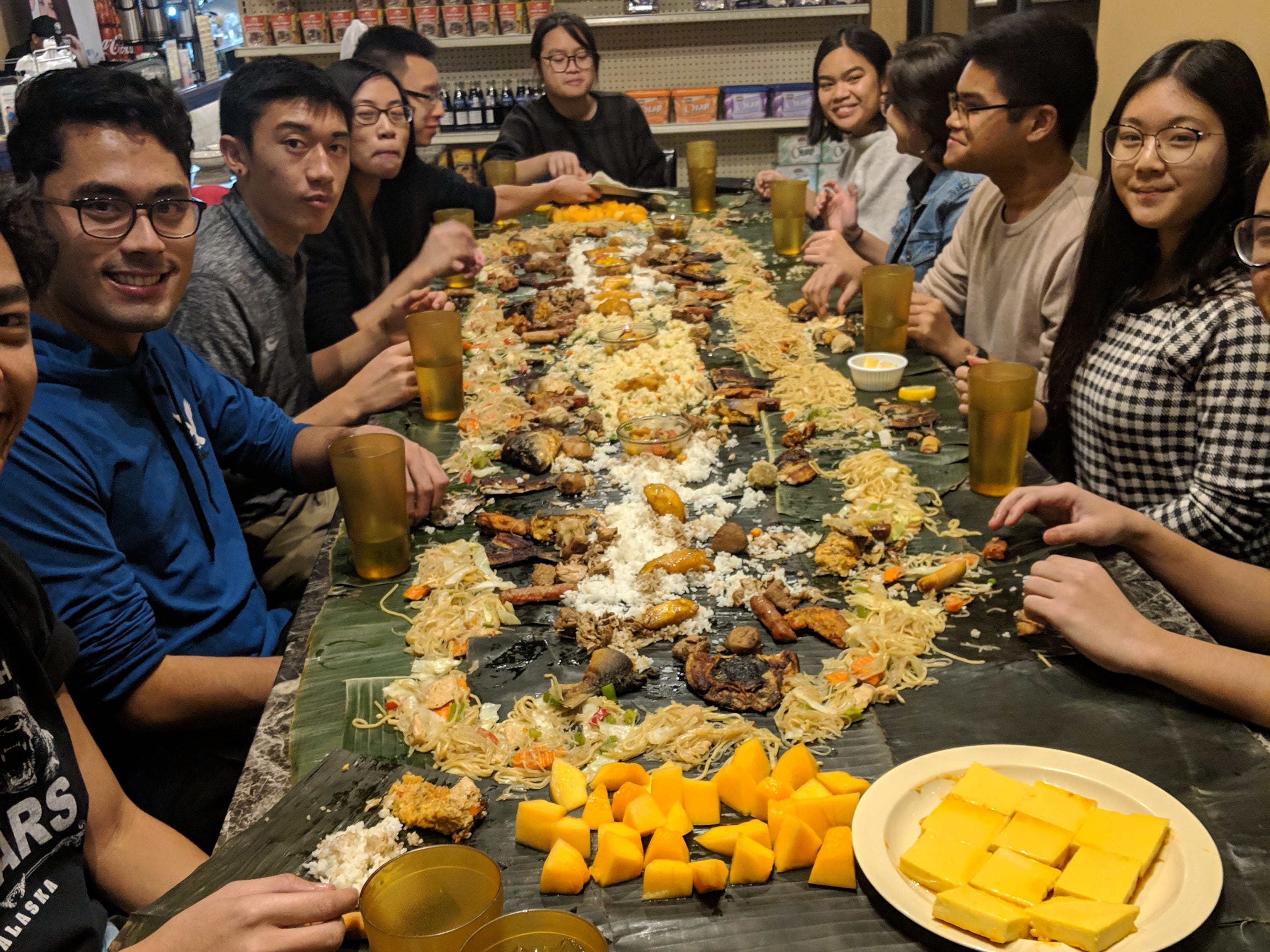 "A table of RIT students get ready for a ""boodle fight"" at Casa Merlita in Gates."