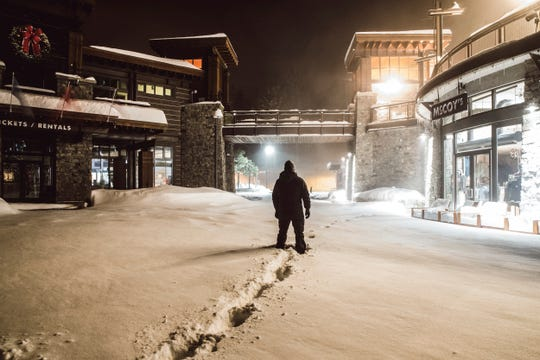 This photo provided by Mammoth Mountain shows a person walking through fresh snow fall on Monday, Jan. 7, 2018 at Mammoth Mountain, in Mammoth Lakes, Calif. The National Weather Service on Monday issued a winter storm warning for areas in the Sierra Nevada above 4,000 feet (1,200 meters), saying snowy and gusty conditions will limit visibility. (Peter Morning/Mammoth Mountain via AP)