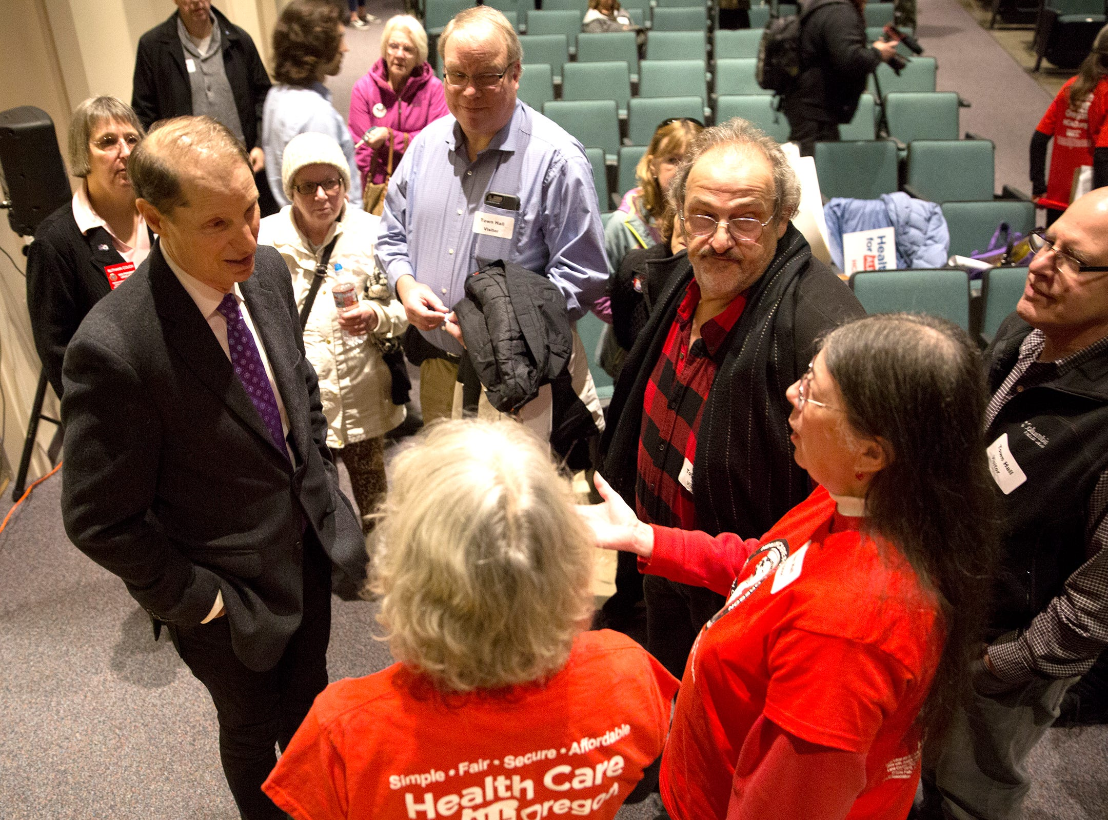 Constituants talk to Sen. Ron Wyden after a Marion County town hall at Woodburn High School on Monday, Jan. 7, 2019.
