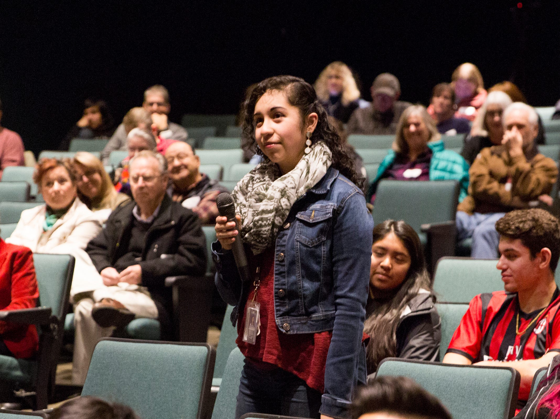 Sophomore Brenda Martinez (center) waits to hear Sen. Ron Wyden answer her question at a Marion County town hall at Woodburn High School on Monday, Jan. 7, 2019.