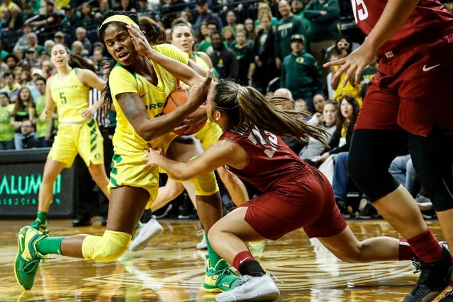 Oregon forward Ruthy Hebard (24) battles for the ball against Washington State guard Cherilyn Molina (33) during an NCAA college basketball game Sunday, Jan. 6, 2019, in Eugene, Ore. (AP Photo/Thomas Boyd)