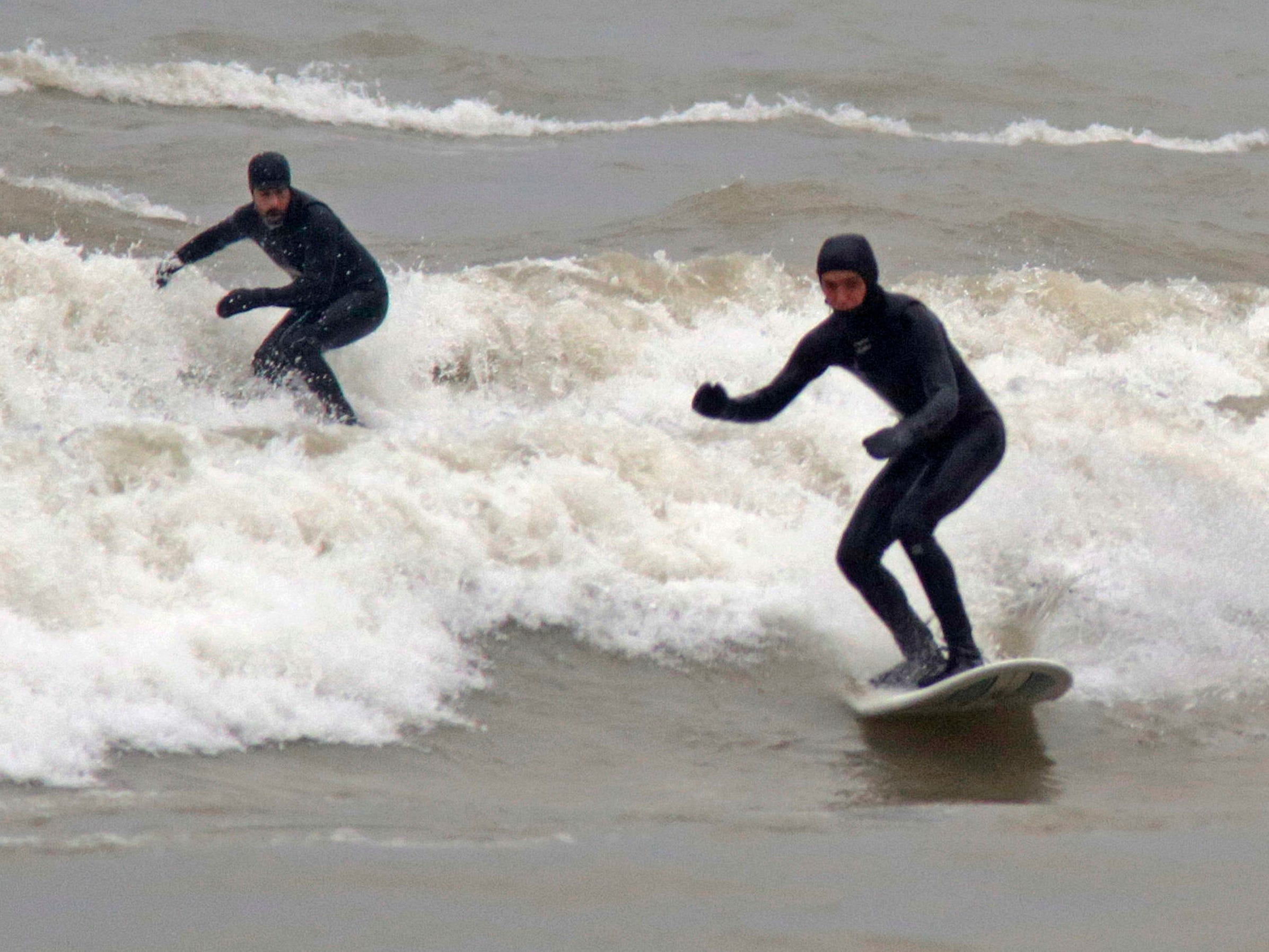 Surfers take on the waves at Deland Park, Monday, January 7, 2019, in Sheboygan, Wis. Westerly winds of 15-25 knots were expected to be in the 3 to 8 foot range with possibilities as high as 10 feet.