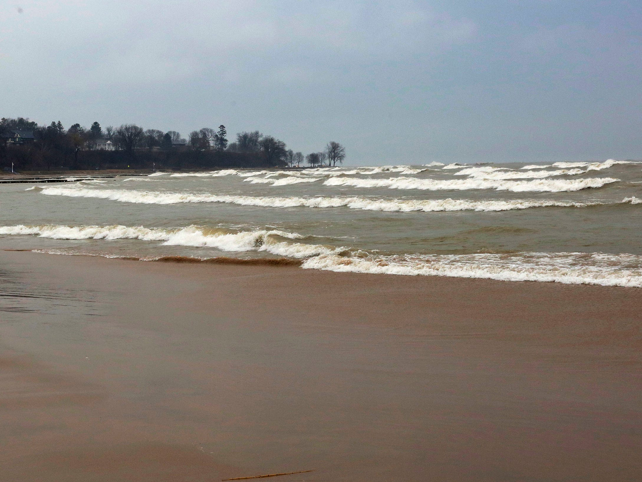 Waves arrive at Deland Park, Monday, January 7, 2019, in Sheboygan, Wis. Westerly winds of 15-25 knots were expected to be in the 3 to 8 foot range with possibilities as high as 10 feet.