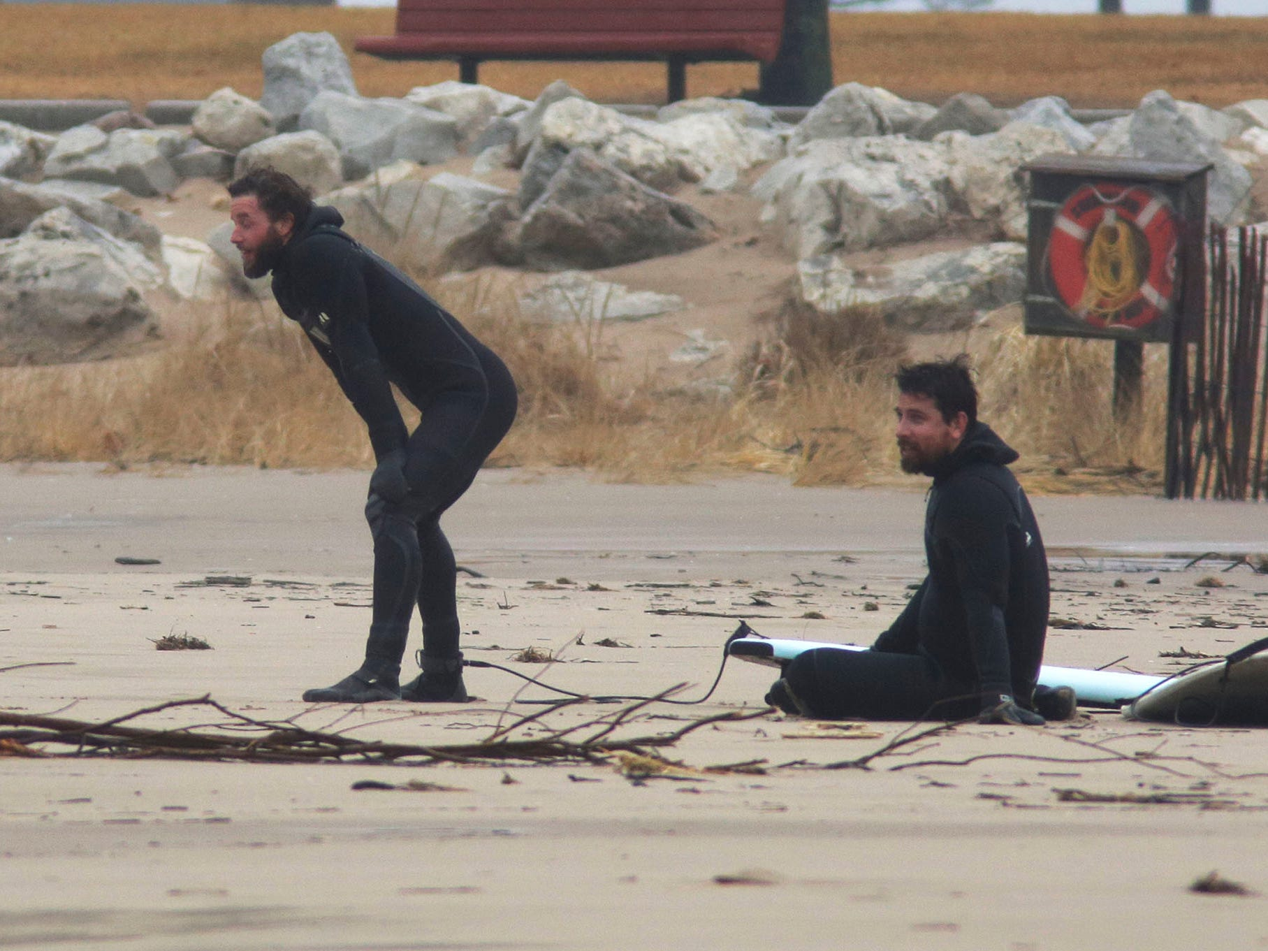 Surfers take a breather between waves at Deland Park, Monday, January 7, 2019, in Sheboygan, Wis. Westerly winds of 15-25 knots were expected to be in the 3 to 8 foot range with possibilities as high as 10 feet.