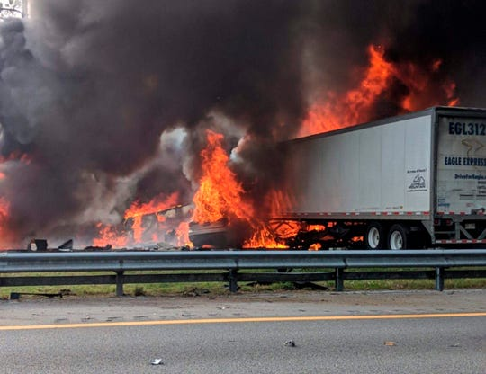 Flames engulf vehicles after a fiery crash along Interstate 75 on Jan. 3, near Gainesville, Florida. Seven people died in the crash, including five children from Marksville. (WGFL-Gainesville via AP)
