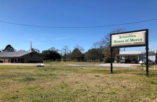 "This photo shows a sign and an exterior of the Avoyelles House of Mercy in Marksville, La., Sunday, Jan. 6, 2019. It was supposed to be a fun, post-Christmas trip to Disney World for 14-year-old Jeremiah Warren and his friends from the church in this small Louisiana town - ""clean fun"" as Warren's aunt described it. But then word came of a fiery crash on a Florida highway that killed seven people, including five children from this area traveling in a church van. (AP Photo/Rebecca Santana)"