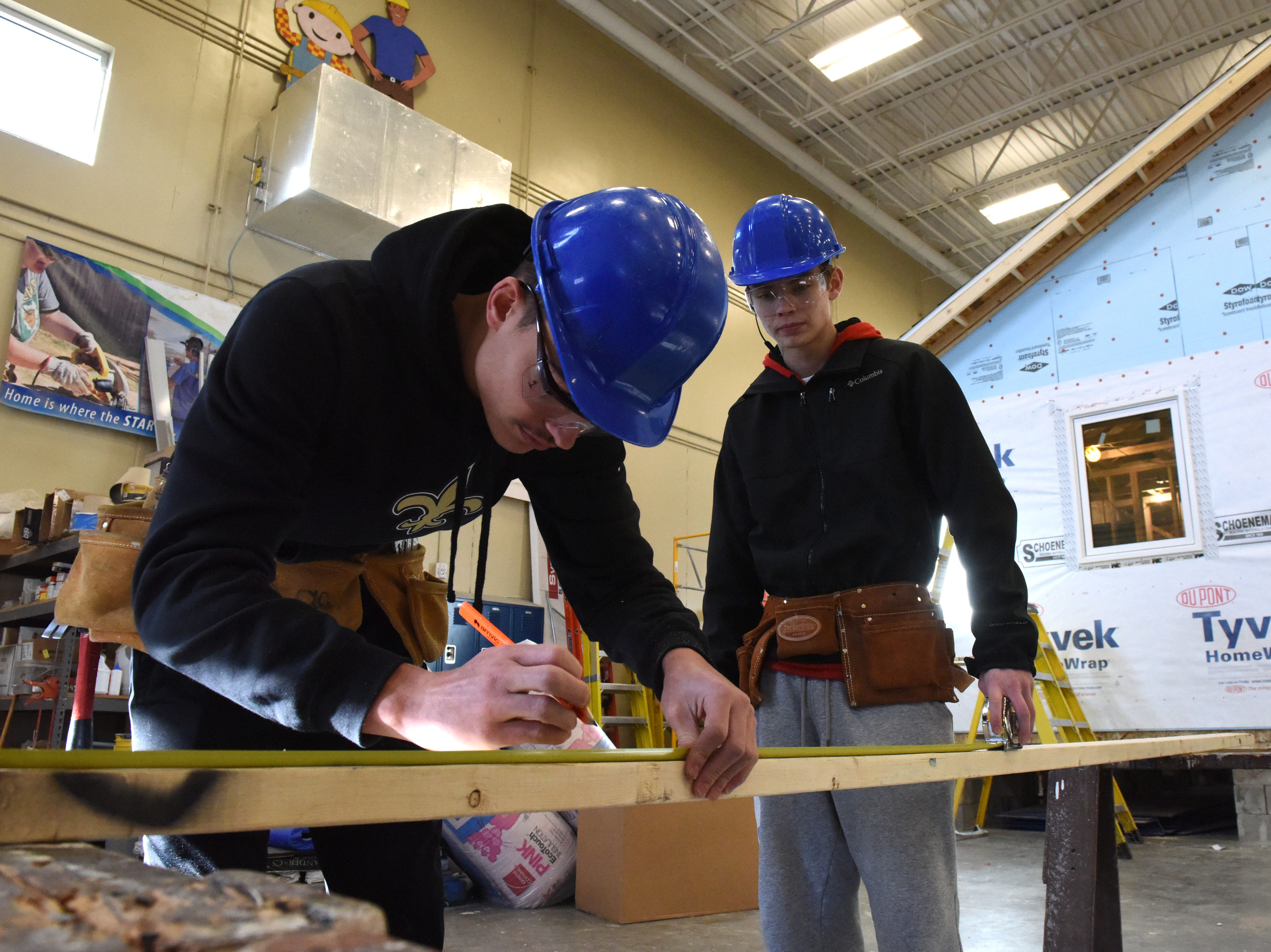 Douglas Wells, left, and Colby Tople participate in carpentry class at Career and Technical Education Academy, Monday, Jan. 7, 2019 in Sioux Falls, S.D.
