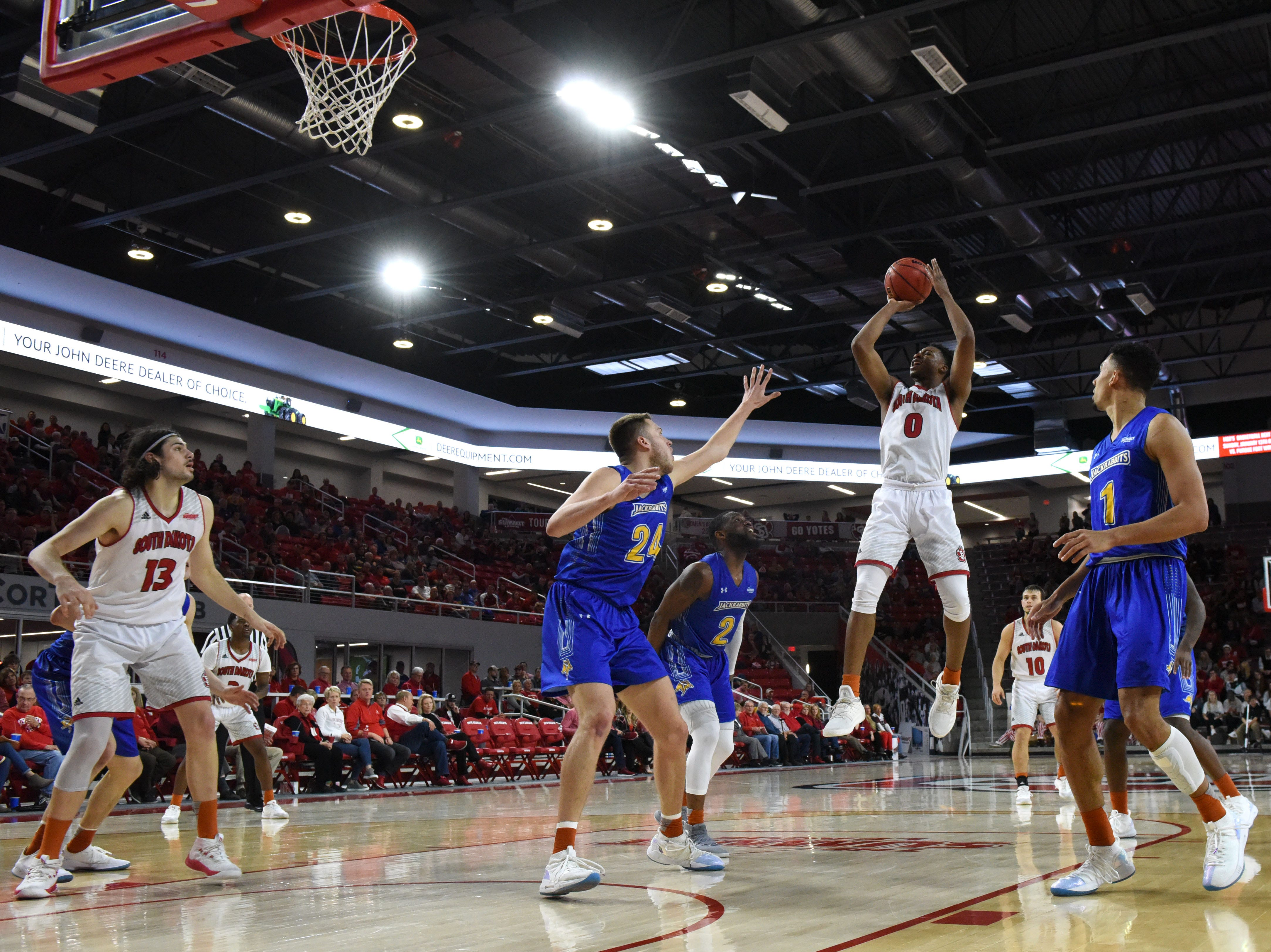 USD's Stanley Umude (0) shoots the ball during a game against SDSU, Sunday, Jan. 6, 2019 in Vermillion, S.D.