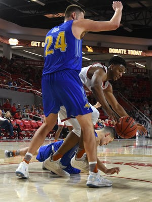 USD's Stanley Umude (0) goes for the ball during a game against SDSU, Sunday, Jan. 6, 2019 in Vermillion, S.D.