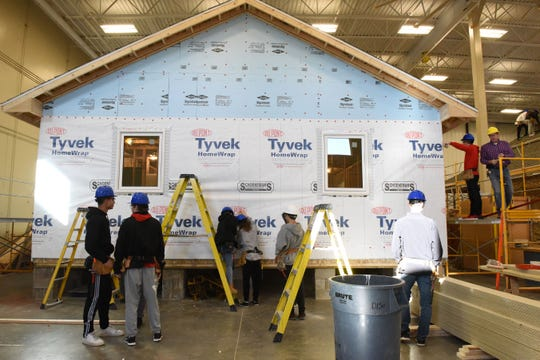 Students build a house in carpentry class at Career and Technical Education Academy, Monday, Jan. 7, 2019 in Sioux Falls, S.D.