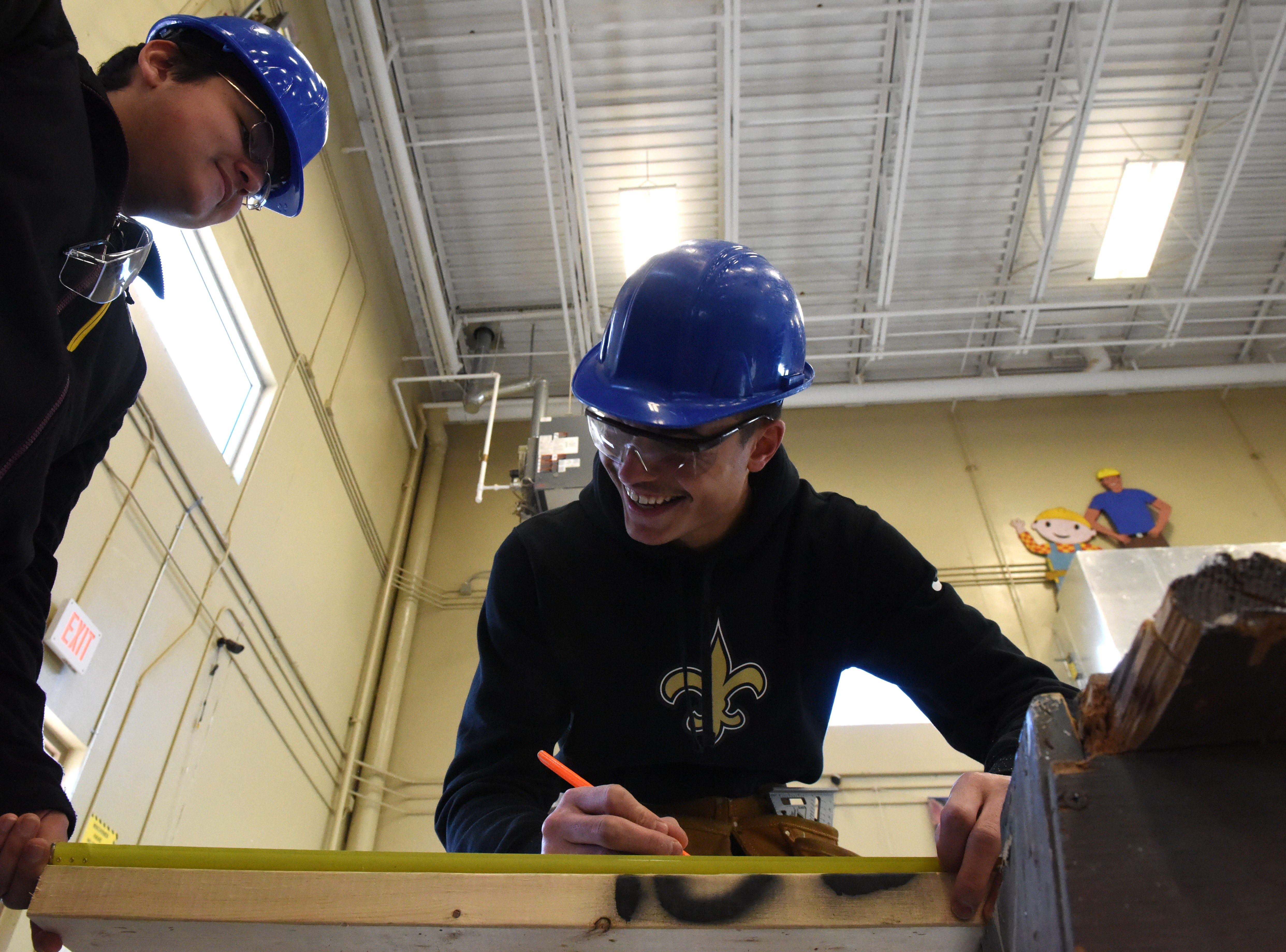 Alan Navarro, left, and Douglas Wells participate in carpentry class at Career and Technical Education Academy, Monday, Jan. 7, 2019 in Sioux Falls, S.D.