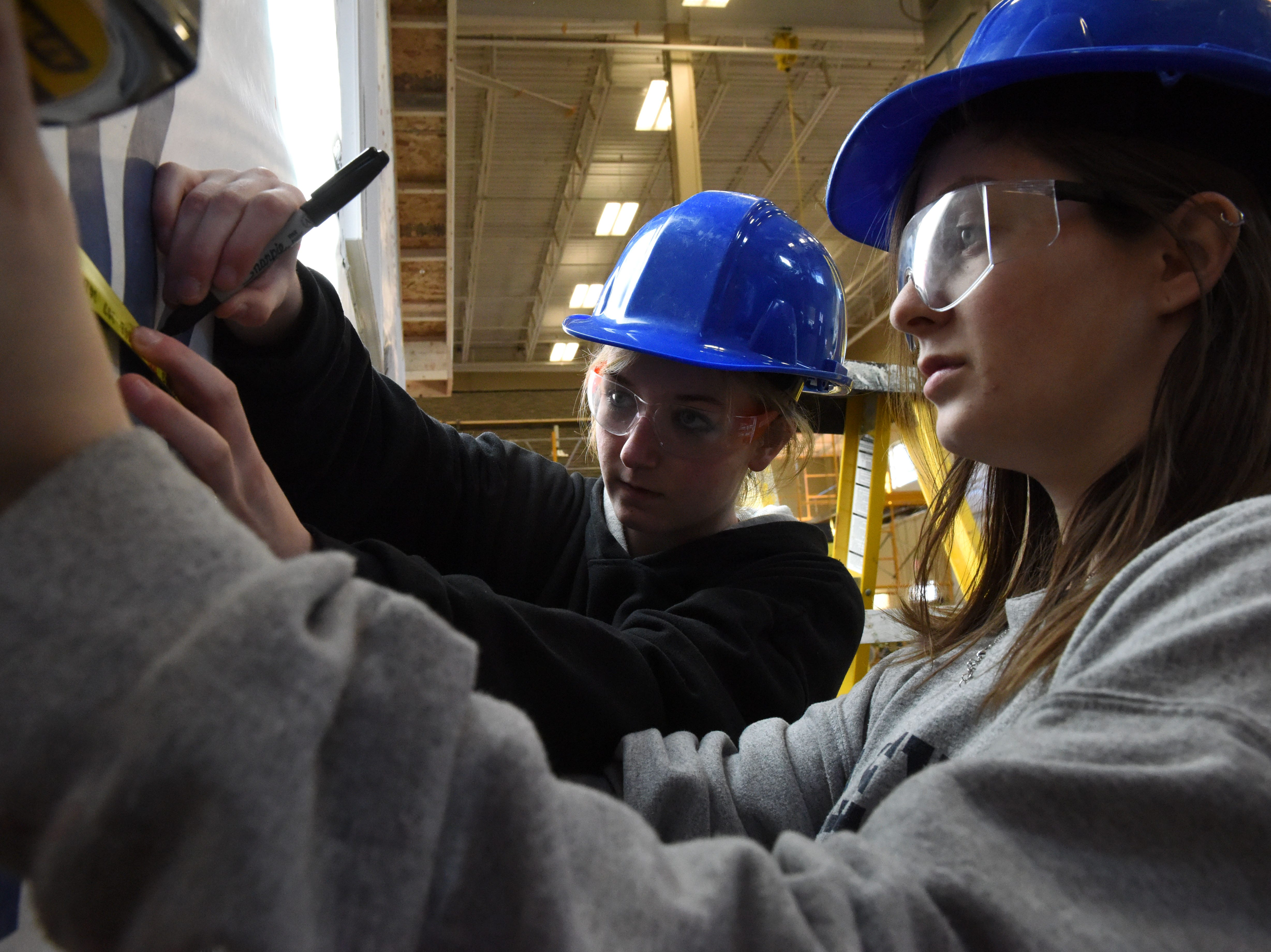 Heidi Griebel and Josie Wahl participate in carpentry class at Career and Technical Education Academy, Monday, Jan. 7, 2019 in Sioux Falls, S.D.