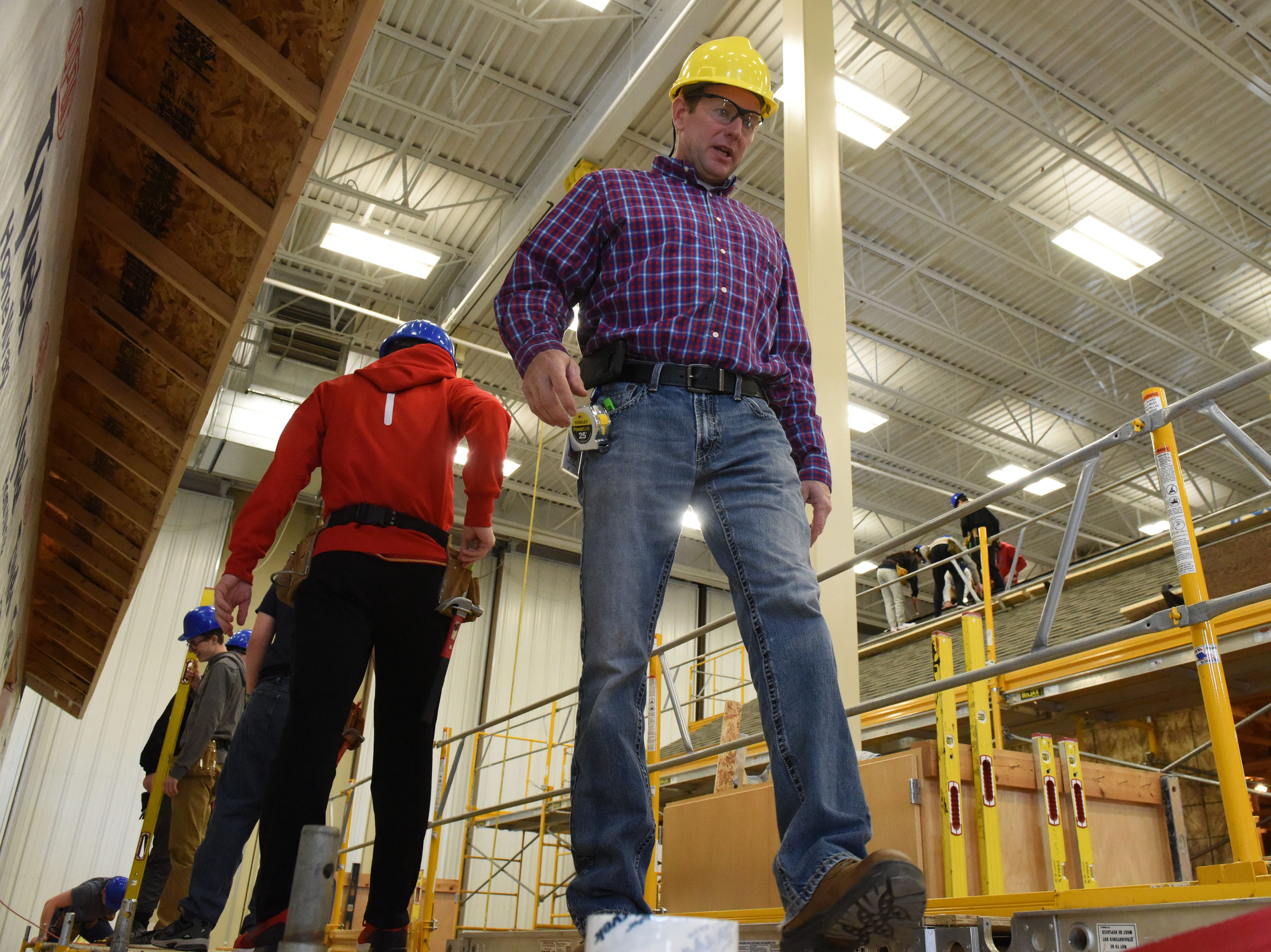 Instructor Nick Opdahl teaches his students how to build a house in carpentry class at Career and Technical Education Academy, Monday, Jan. 7, 2019 in Sioux Falls, S.D.