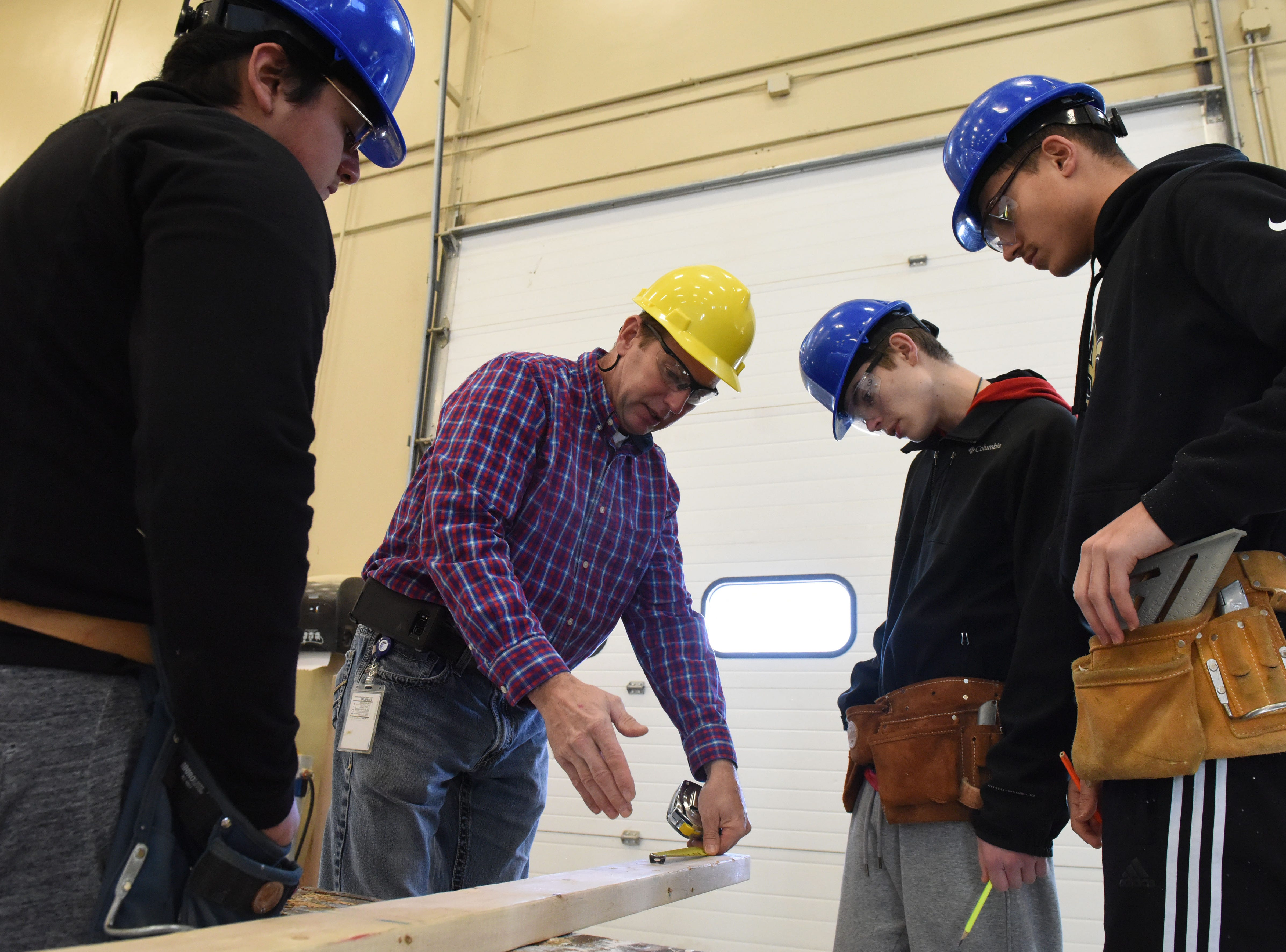 Nick Opdahl instructs his students, Alan Navarro, left, Douglas Wells and Colby Tople during carpentry class at Career and Technical Education Academy, Monday, Jan. 7, 2019 in Sioux Falls, S.D.