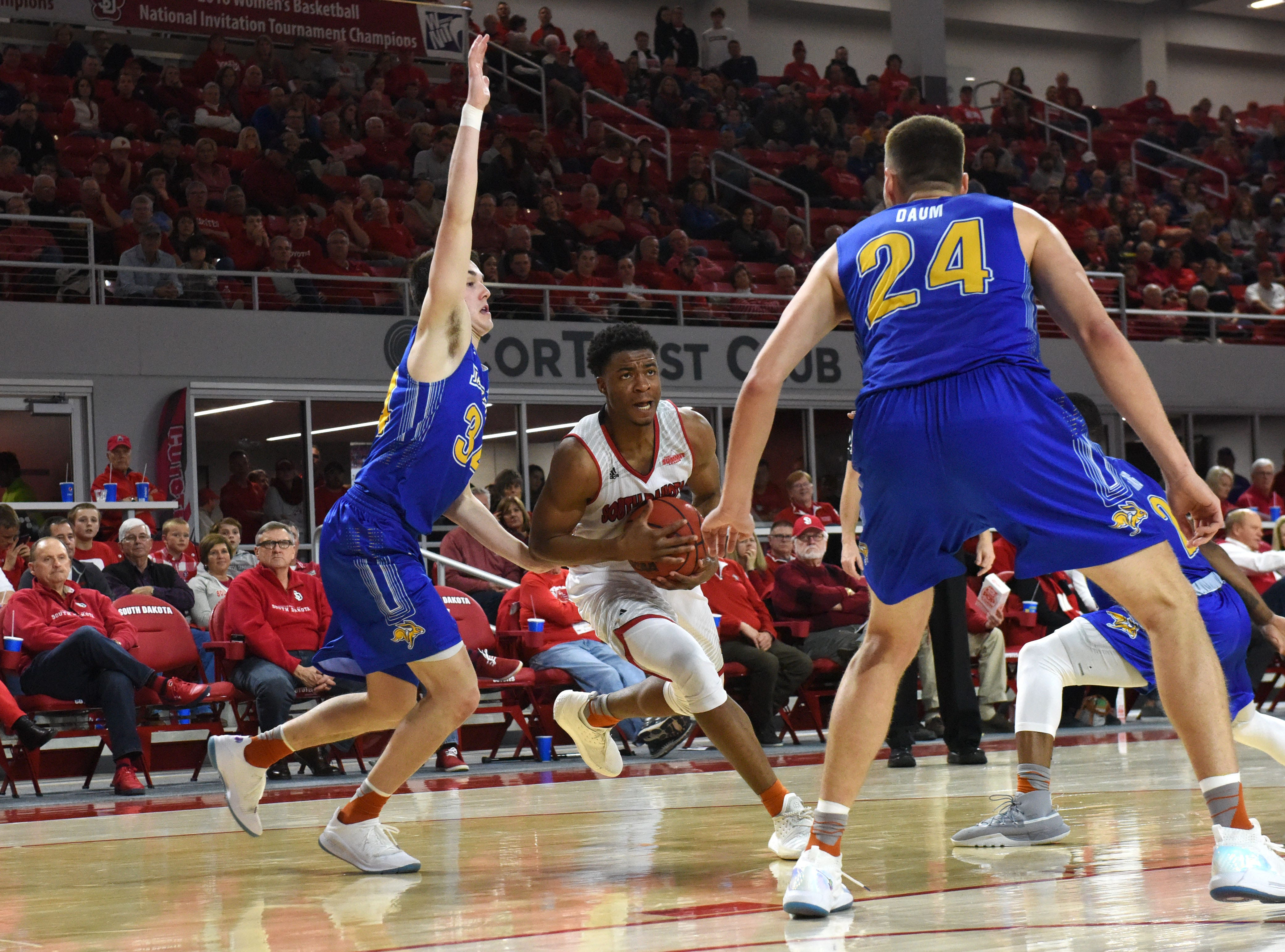 USD's Stanley Umude (0) dribbles the ball past SDSU players during a game, Sunday, Jan. 6, 2019 in Vermillion, S.D.