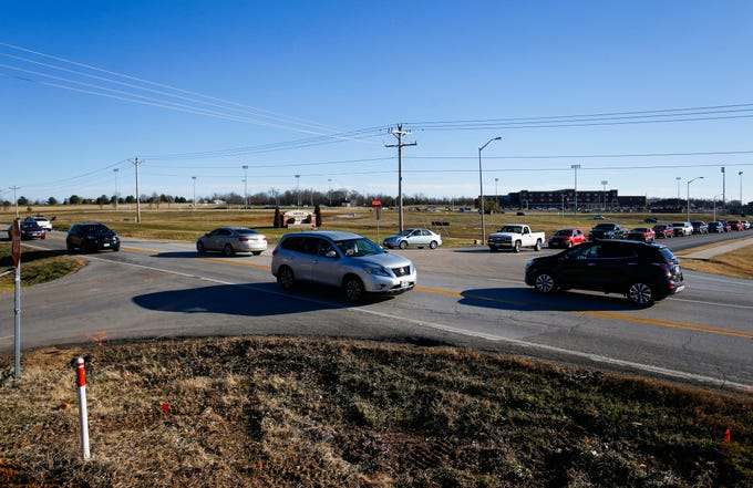 Traffic at the intersection of M Highway, and Farm Road 103 as Republic High School lets out for the day on Monday, Jan. 7, 2019. Construction of a one-lane roundabout to ease traffic and improve safety has begun.