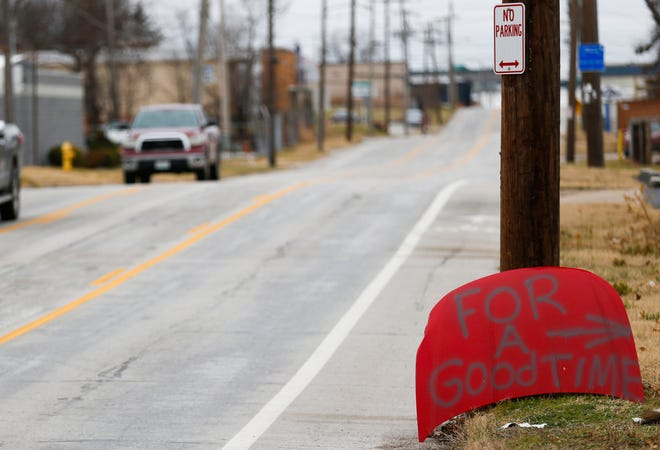 For months someone has been spray-painting messages -- some bizarre, some funny, some lurid -- on vehicle hoods that are placed in front of vacant property on East Trafficway Street.  The hoods disappear, only to be replaced by different hoods with new messages.