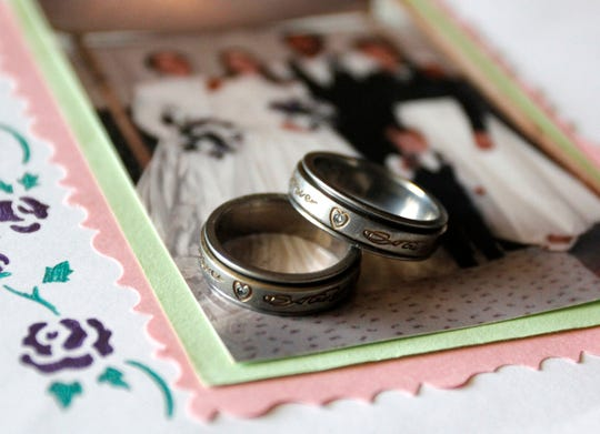 """Matching rings inscribed """"Always and Forever"""" were given to Sarah and Heather Staples by Charles Laub. Photo taken at the Staples home in Hickory County on March 16, 2011."""