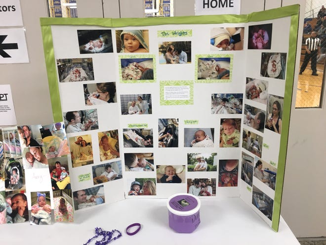 A photo display at Western Albemarle High School Saturday for the Play for Preemies Showcase helped tell the story of Kris and Heather Wright and their children.