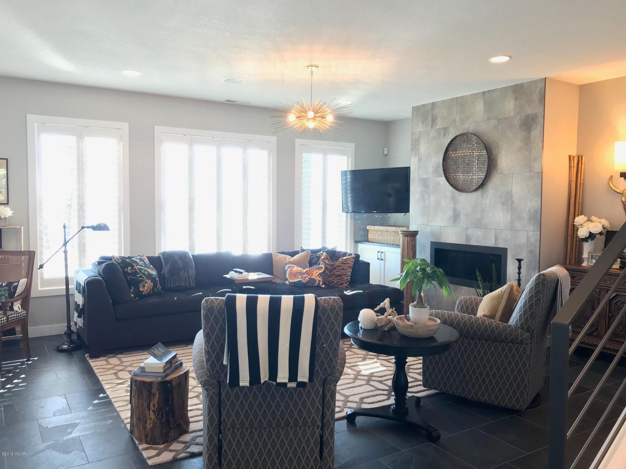 The living room features a floor-to-ceiling fireplace.