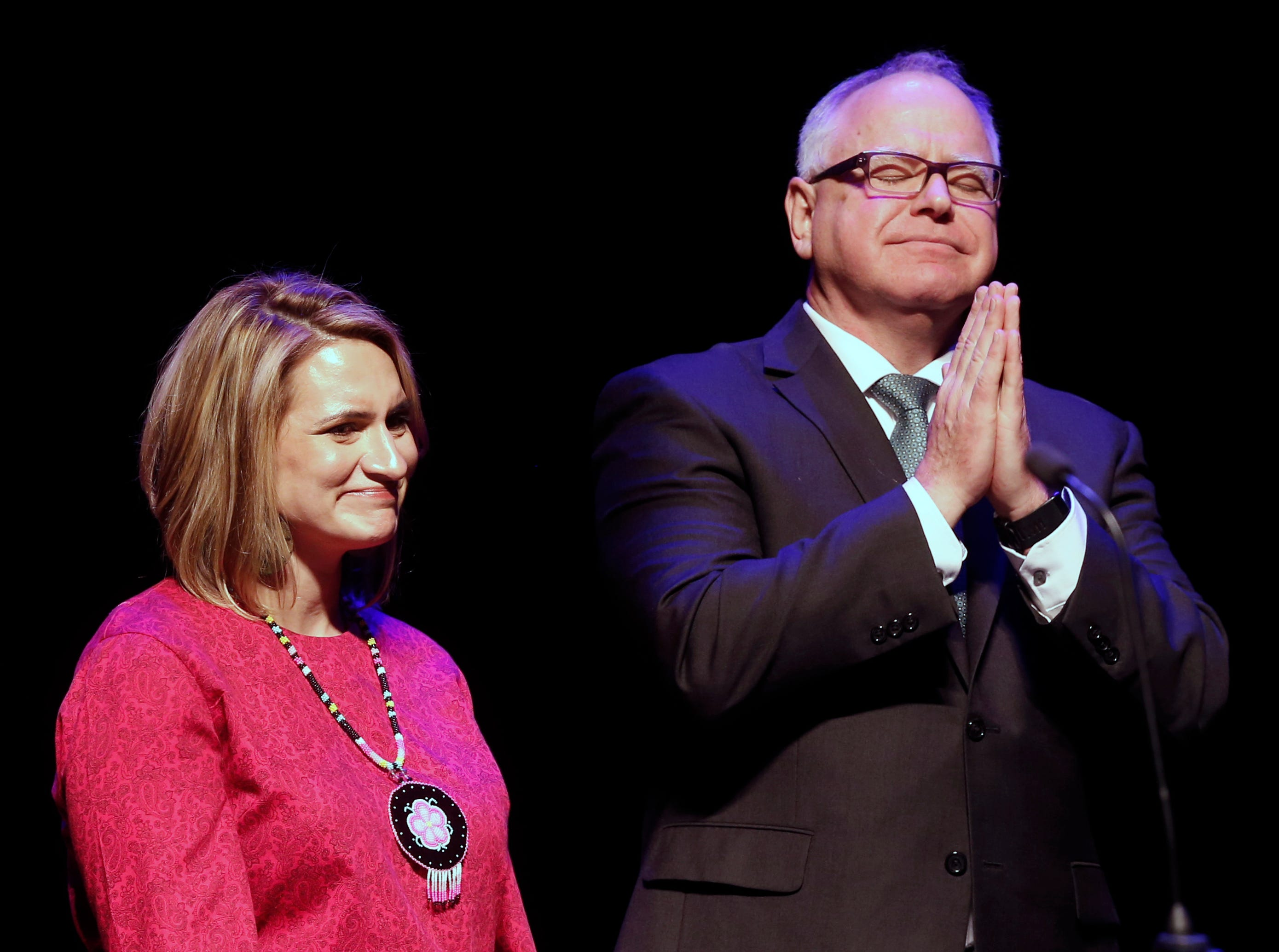 New Minnesota Governor Tim Walz acknowledges the crowd following his inaugural address after he and Lt. Gov. Peggy Flanagan were sworn in Monday, Jan. 7, 2019, in St. Paul, Minn. (AP Photo/Jim Mone)