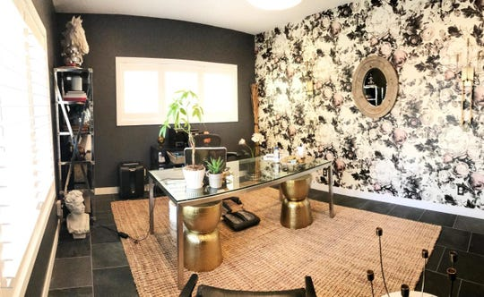The main floor holds a stylish office decorated in stunning Ellie Cashman wallpaper.
