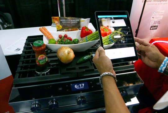 Whirlpool Corporation and Yummly team up to create smart cooking appliances through a series of over the air updates to both product software and the Whirlpool and Yummly Guided Cooking brand apps, at the CES Unveiled at CES International Sunday, Jan. 6, 2019, in Las Vegas. (AP Photo/Ross D. Franklin)