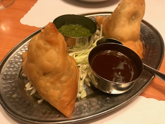 The vegetable samosa appetizer at Red Fort Indian Cuisine is filled with a creamy, wholesome filling of potatoes, peas and curry spices.