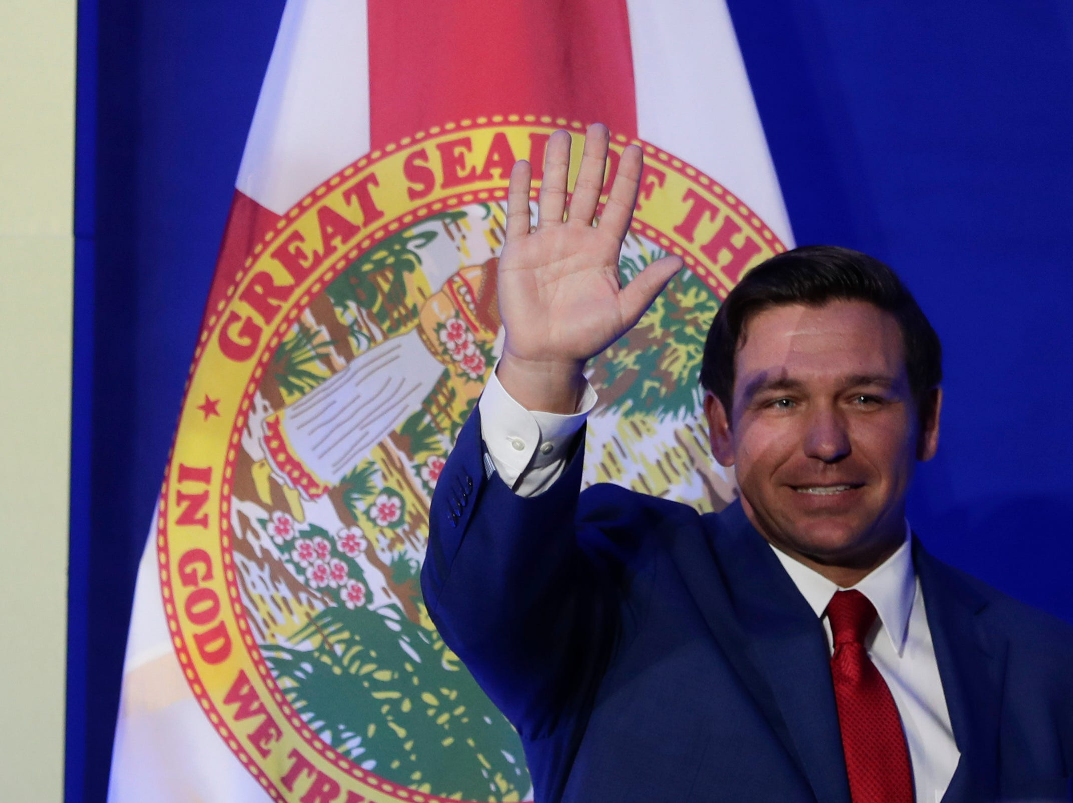 Gov. Ron DeSantis leaves the stage after speaking during the Bold Vision for a Bright Future: Thought Leaders Luncheon in the University Center Club at Florida State University Monday, Jan. 7, 2019.
