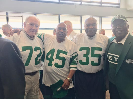 Former FAMU football head coach Billy Joe (35) celebrates the 50th anniversary of the New York Jets winning Super Bowl III with teammates Paul Rochester (72), Earl Christy (45) and Emerson Boozer.