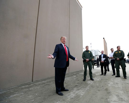 President Donald Trump tours the border wall prototypes near the Otay Mesa Port of Entry in San Diego County, Calif., on March 13, 2018.
