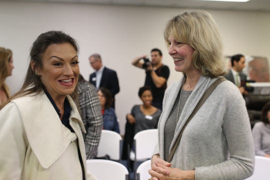 Florida Commissioner of Agriculture and Consumer Services Nikki Fried, left, speaks with County Commissioner Mary Ann Lindley at a meeting with Second Harvest Food Bank, Monday, Jan. 7, 2019.
