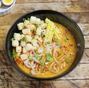 Veggie curry noodles made with coconut curry based broth, tofu, corn, mushrooms,  green onions and seasonal greens at the new Downtown Ramen Bar.