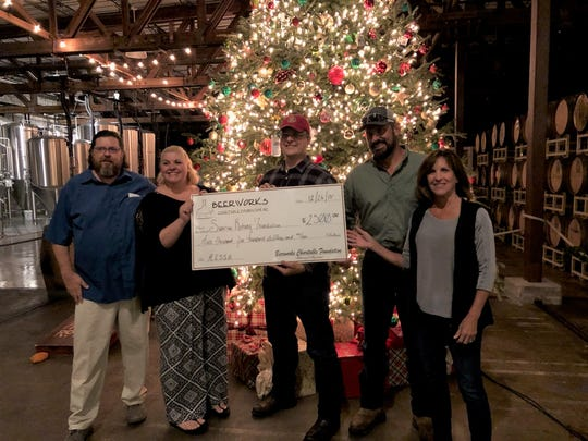 Beerworks.org representatives Marc and Mendy Solorzano, left, give a $2,500 check to Sunrise Rotarians and 2019 Brew Fest Chairs Kevin Rollin and Ray Hooker and the Beers and Cheers for a Healthy Lagoon Chair Sunrise Rotarian Robin Pelensky.